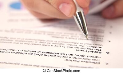 Study of contract rents with pen in hand