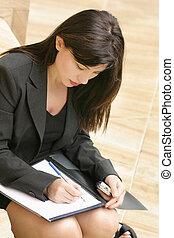 Woman studying, wriring, notetaking, preparation