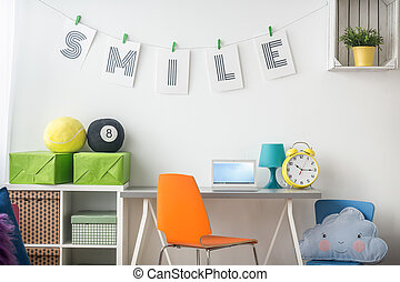 Study room arrangement for teenager with white furniture