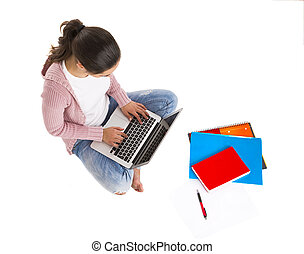 Study time - Young female student sitting with crossed legs...