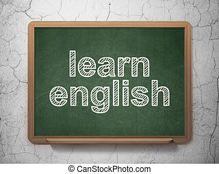 Studying concept: Learn English on chalkboard background - ...