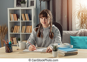 Studying girl siting at desk