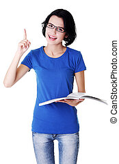 Studying happy young woman reading her notebook