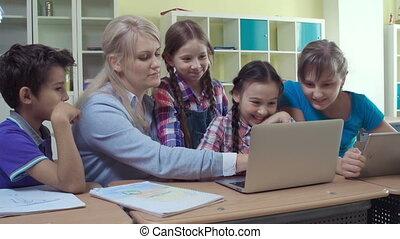 Class enjoying computer studies