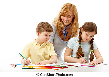 Studying - Portrait of children drawing pictures and teacher...