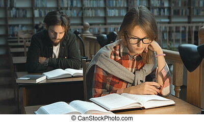 Studying with Pleasure in Library - Persistent student girl...