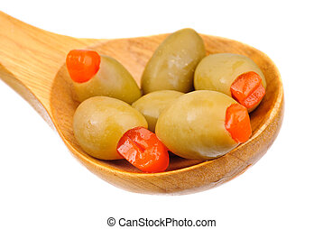 stuffed green olives and wooden spoon isolated on white background