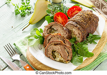 Stuffed Meat Roll with Pear and Cheese on a festive Thanksgiving Day table. Copy space.