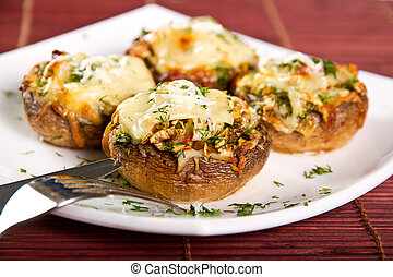 Mushrooms stuffed with vegetables and cheese