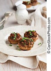 Stuffed mushrooms with bread crumbs, mushroom stems,...