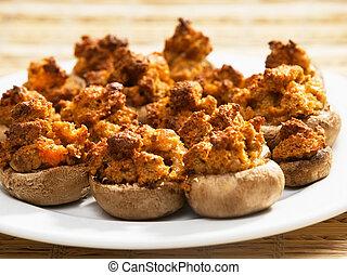 Stuffed mushrooms with crutons, tomato and mozzarella,...