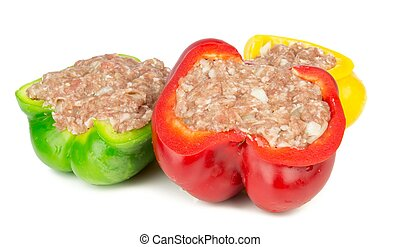 Red yellow and green stuffed paprika on a white background