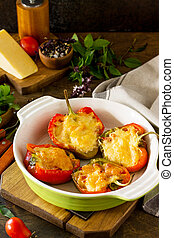 Stuffed peppers with turkey meat and cheese on a wooden table. Healthy food. Copy space.