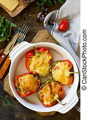 Stuffed peppers with turkey meat and cheese on a wooden table. Healthy food. Top view flat lay background. Copy space.