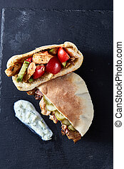 Stuffed pita bread with grilled vegetables, pork chops and ...