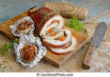 Stuffed Pork Loin Roast with baked garlic