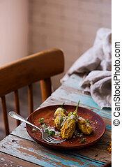 stuffed pumpkin flowers with potato. selective focus