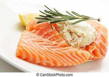 Stuffed salmon - A piece of stuffed salmon on a plate
