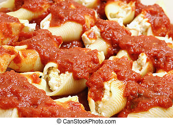 Stuffed Shells - Stuffed shells with ricotta cheese with red...