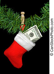 Hundred dollar bill stuffed in a holiday stocking.