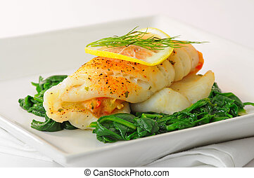 Stuffed Sole - Sole stuffed with crab on a bed of spinach.
