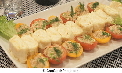 Stuffed tomatoes with cheese and cheese rolls
