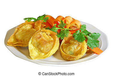 Plate of stuffed wontons isolated on white