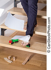 Stumbling on toy car lied on the stairs