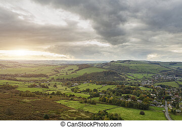 Stunning Autumn Fall landscape aerial drone image of countryside view from Curbar Edge in Peak District England at sunset