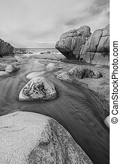 Stunning beach landscape with pastel colors in morning light in black and white