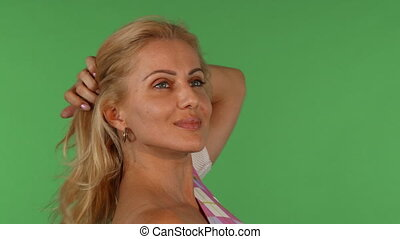 Stunning beautiful mature woman smiling playing with her hair
