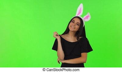 Stunning beautiful woman in black dress wearing bunny ears -...