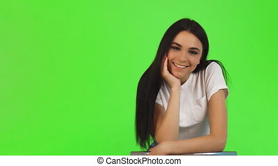 Stunning beautiful young woman smiling to the camera