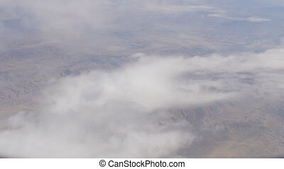Stunning beauty floats over desert mountain landscape. Top...