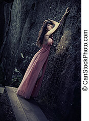 Stunning beauty in a fashionable dress