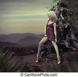 Stunning blond lady posing in the evening
