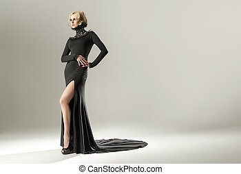 Stunning blond woman wearing black gown