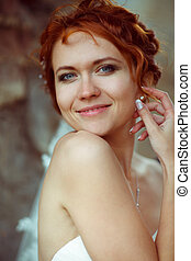 Stunning bride adjusts her earring