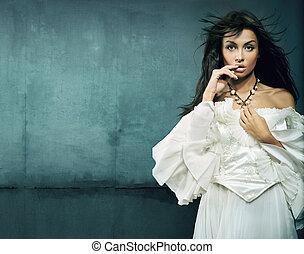 Stunning brunette beauty wearing vintage dress