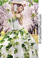 Stunning brunette in a spring garden