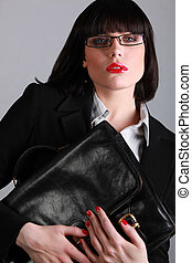 Stunning businesswoman with a black leather briefcase