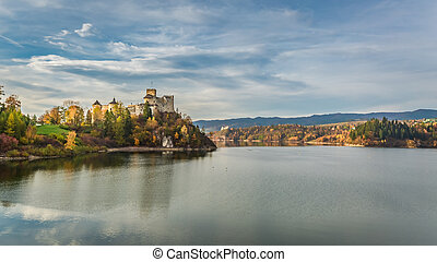 Stunning castle by the lake at dusk in autumn