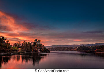 Stunning dusk over castle by the lake in Niedzica