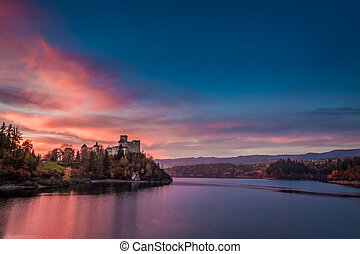 Stunning dusk over castle by the lake, Poland