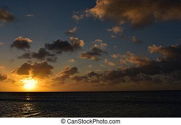Stunning Firey Sun Setting Over the Ocean on the Horizon