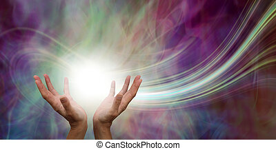 female hands reaching up into a ball of white energy with a laser trail and pink green ethereal energy field background
