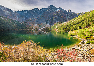 Stunning lake in the mountains at dawn in autumn