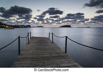 Stunning landscape dawn sunrise over jetty and long exposure Med