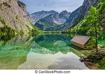 Stunning little cottage on the lake Obersee in Alps