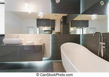 Stunning modern bathroom design - Freestanding bathtub in...